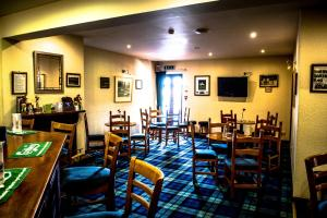 A restaurant or other place to eat at Carnegie Lodge Hotel