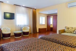 Кровать или кровати в номере У истока