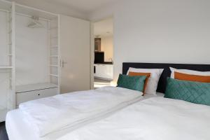 Een bed of bedden in een kamer bij De Overtoom 68