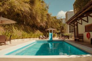 The swimming pool at or close to Hotel Marambaia Cabeçudas - frente mar