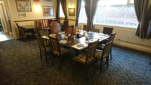 A restaurant or other place to eat at Blue Boar Inn