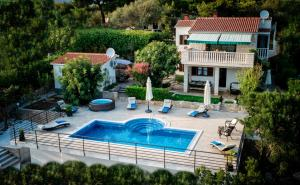 A view of the pool at Villa Nela or nearby