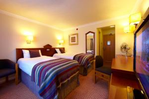 A bed or beds in a room at Village Hotel Hull