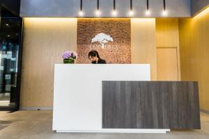 The lobby or reception area at Eco Tree Hotel Causeway Bay