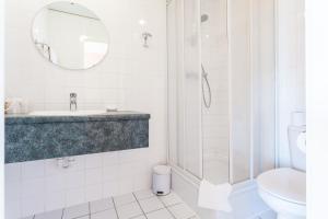 Een badkamer bij Avenue Boutique Hotel