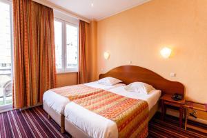 Een bed of bedden in een kamer bij Malecot Boutique Hotel