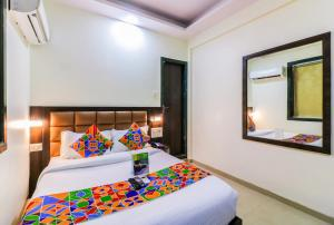 A bed or beds in a room at FabExpress National Residency Chembur