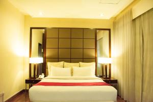 A bed or beds in a room at Serai Boutique Hotel
