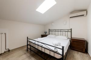Postelja oz. postelje v sobi nastanitve B&B Miracolo di Mare Retro
