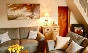 A seating area at Nant Melyn Cottage