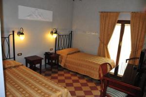 Cama ou camas em um quarto em Hotel Della Robbia