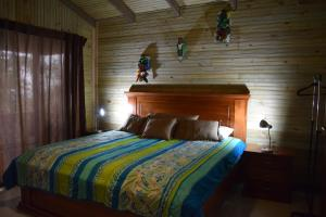A bed or beds in a room at Mirador Valle del General