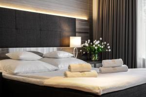 Łóżko lub łóżka w pokoju w obiekcie Hotel Villa Eva