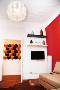Uma televisão e/ou sistema de entretenimento em Fullest Apartments