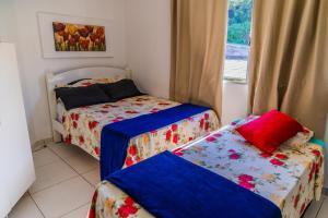 Cama ou camas em um quarto em Pousada Praia do Ribeiro