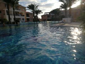 The swimming pool at or near Iris village holiday apartment