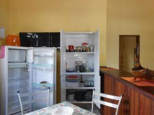 A kitchen or kitchenette at Apartamento Aconchegante