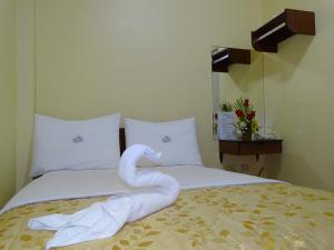 A bed or beds in a room at Hotel Primavera