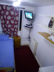 A television and/or entertainment center at Private Cosy Roomz
