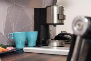 Coffee and tea making facilities at Best Western Hotel Cologne Airport Troisdorf