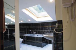 A bathroom at La Fischhutte, The Originals Relais (Relais du Silence)