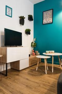 Télévision ou salle de divertissement dans l'établissement Appartement Rohaut 4p - LocationAmiens