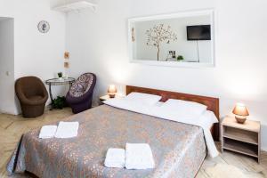 Ліжко або ліжка в номері Апартаменты в центре (площадь Рынок)