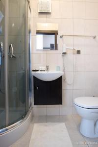 Łazienka w obiekcie Hotel Millenium