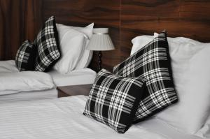 A bed or beds in a room at Argyll Guest House