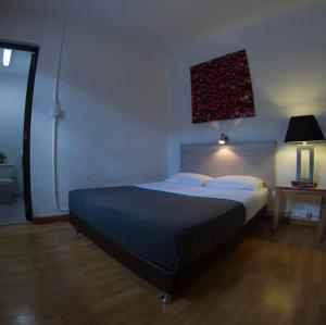 A bed or beds in a room at Explora Hostels