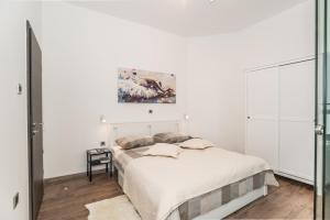 A bed or beds in a room at Apartment Mille