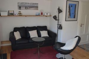 Ein Sitzbereich in der Unterkunft Panorama-Blick Miltenberg, 3 Pers., zentr., am Main, Terrasse, Bootverleih, P