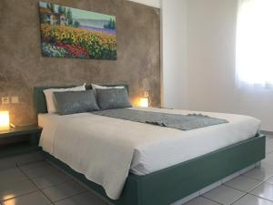 A bed or beds in a room at Evdokia Suites