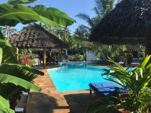 The swimming pool at or near Aluna Nungwi