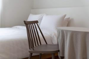 ホテル キョンソンにあるベッド