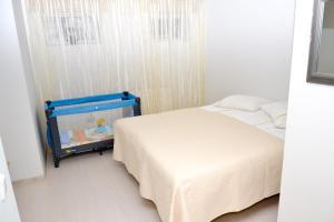 Voodi või voodid majutusasutuse Kuressaare Tolli Apartment toas