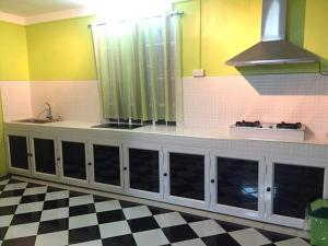 A kitchen or kitchenette at Holiday Home