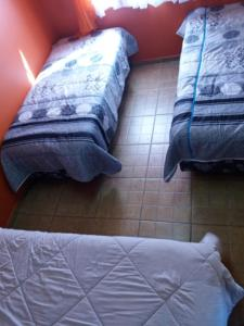 A bed or beds in a room at Apartamento Dois