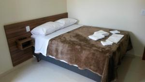 A bed or beds in a room at Hotel Moara