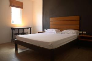 A bed or beds in a room at Solaris 88 Inn