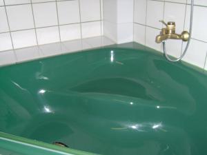 Ein Badezimmer in der Unterkunft Am Hallenbad Hotel garni