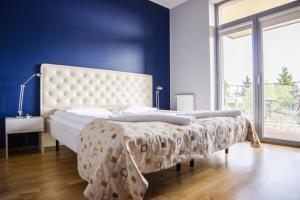 Łóżko lub łóżka w pokoju w obiekcie Apartamenty Sun & Snow Bałtyk Park