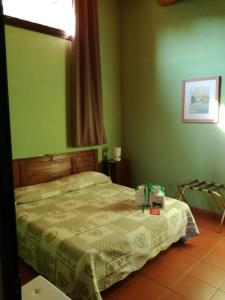 A bed or beds in a room at Agriturismo Il Colle