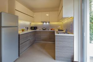 A kitchen or kitchenette at SAGITTARIUS - FALIRO SEA SIDE APARTMENT