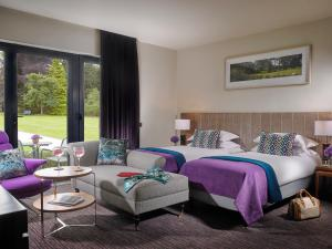 A bed or beds in a room at Farnham Estate Spa and Golf Resort