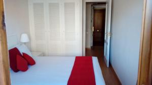 A bed or beds in a room at Roomspace Cuzco