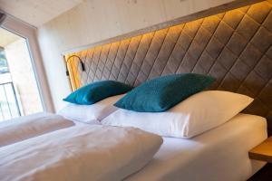 Ein Bett oder Betten in einem Zimmer der Unterkunft Haus Christophorus