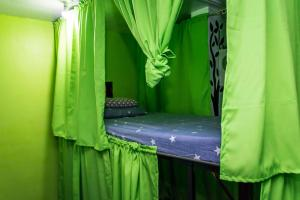 A bed or beds in a room at Haven Backpackers Hostel