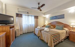 Una cama o camas en una habitación de Hotel Tronador