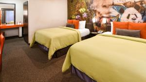 A bed or beds in a room at The Tangerine